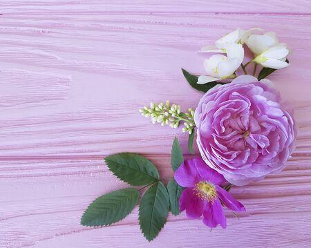 rose frame wooden background