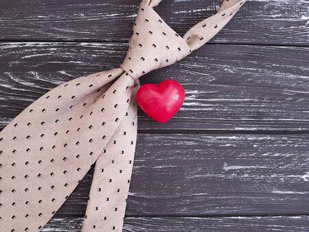 tie heart wooden background