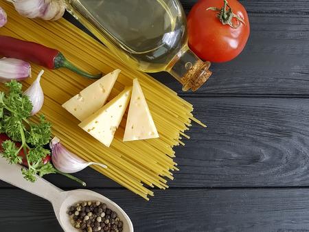 garlic spaghetti on a wooden background