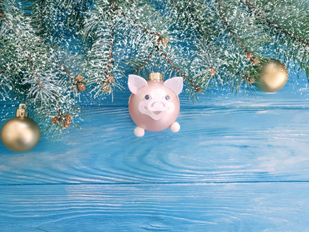 Christmas toy pig on a wooden background 写真素材
