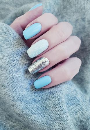 female hand manicure sweater
