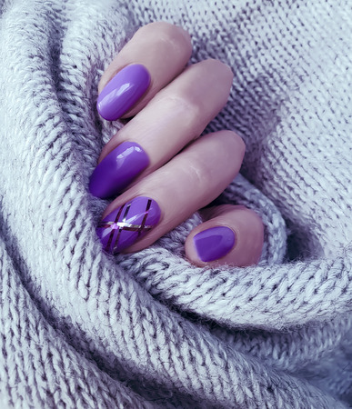 female hand manicure sweater