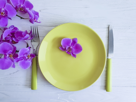 orchid flower plate on wooden background Stock Photo