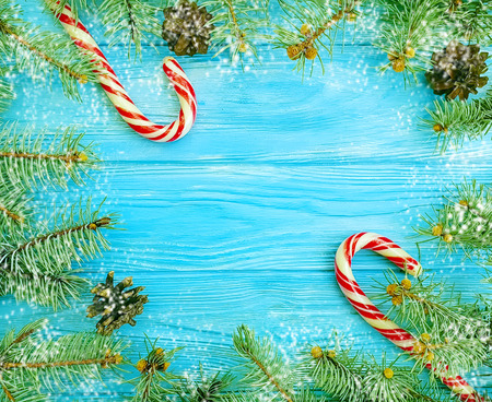 candy tree branch on blue wooden background