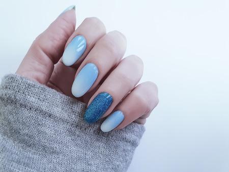 female hand beautiful manicure sweater