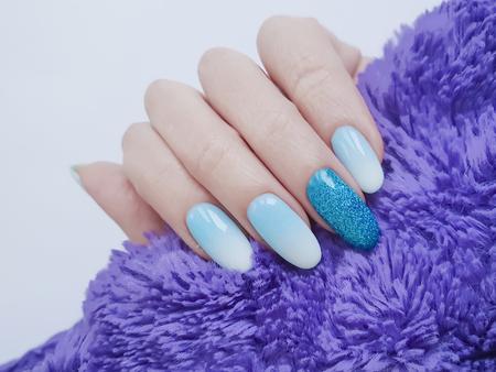 female hands beautiful manicure, sweater fur acrylic, elegant