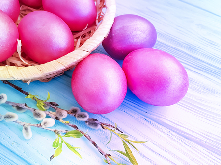 easter eggs, fluffy willow on a wooden background