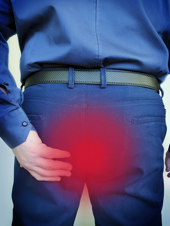 man suffers from hemorrhoids concept, discomfort immediate
