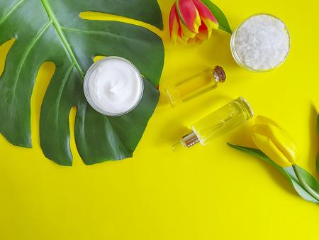 cosmetic cream, flower tulip, monstera leaf