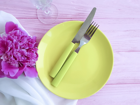 peony flower plate on pink wooden