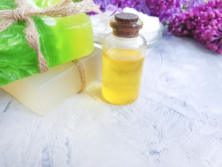 cosmetic oil, lilac on a gray concrete background Фото со стока