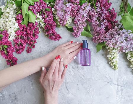 female hands, beauty cream, lilac