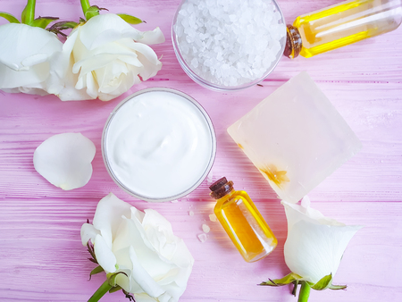 cosmetic cream, rose flower, salt , Spa and beauty concept