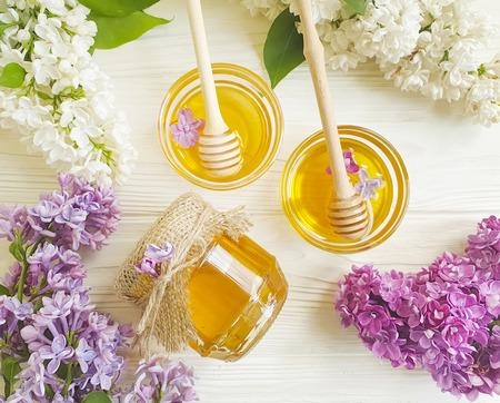 fresh honey lilac flower on wooden background