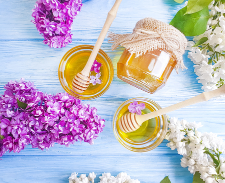 fresh honey lilac flower on wooden background