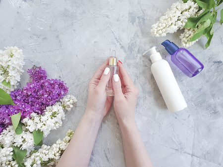 female hands manicure cream cosmetic flower lilac Stockfoto