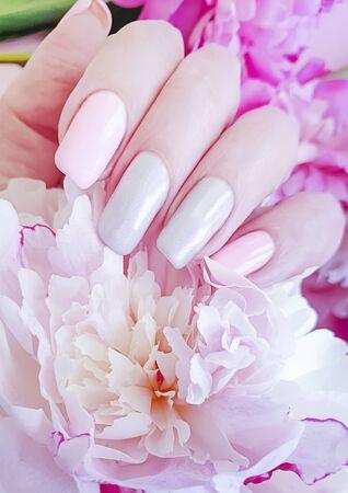 female hand manicure flower peony