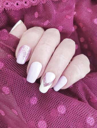 female hand beautiful manicure lace