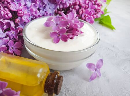 cosmetic cream, salt, oil flower lilac