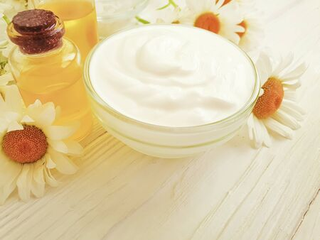 cosmetic cream, chamomile flower