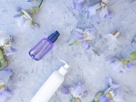 cream cosmetic flower iris on a gray concrete