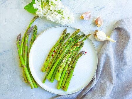 fried asparagus, sesame seeds on a gray concrete 写真素材
