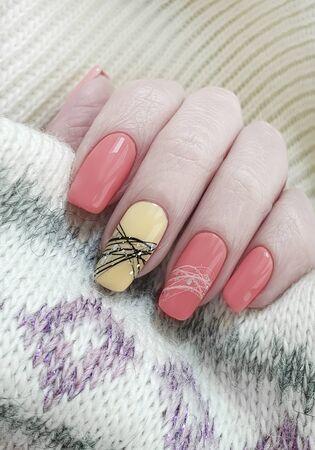 female hand beautiful manicure nails sweater