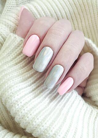 female hand manicure beautiful sweater