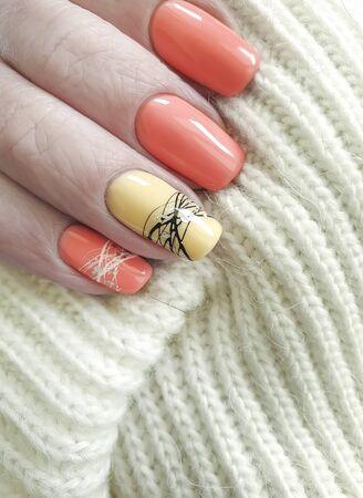 female hand beautiful manicure orange