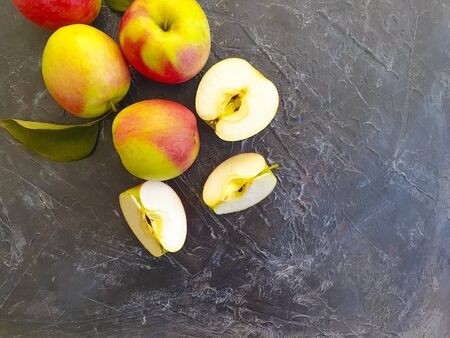 fresh apples on a concrete background, autumn vitamin