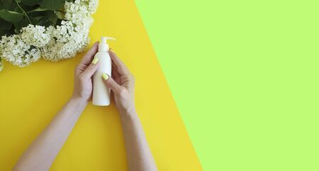woman hands cream, flower