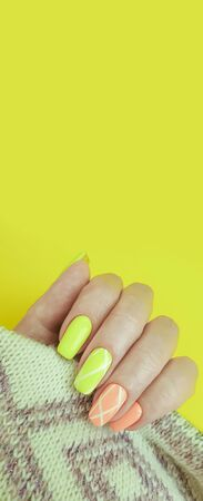 female hand beautiful color manicure sweater