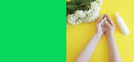 woman hands cream, flower