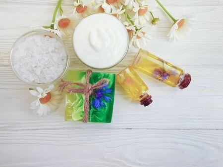 cosmetic cream, flower oil on wooden Banco de Imagens