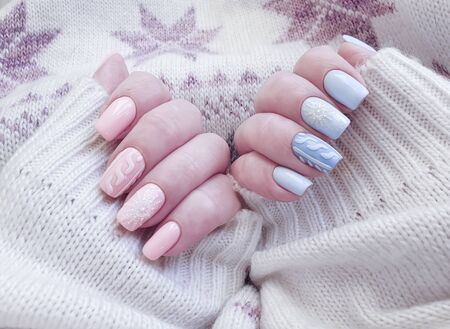 female hand beautiful manicure sweater