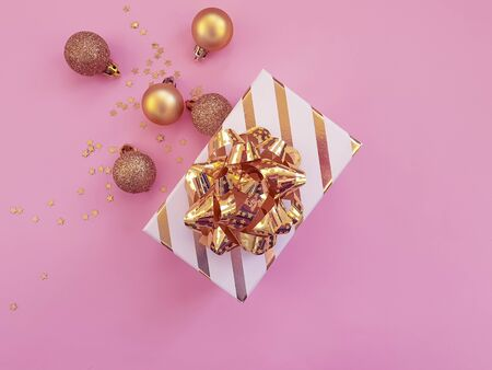 gift box bow, Christmas ball on a colored 写真素材