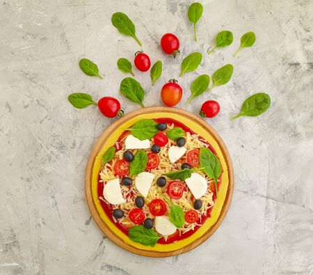 pizza with tomatoes, cheese, olives on a concrete background 写真素材 - 135242217