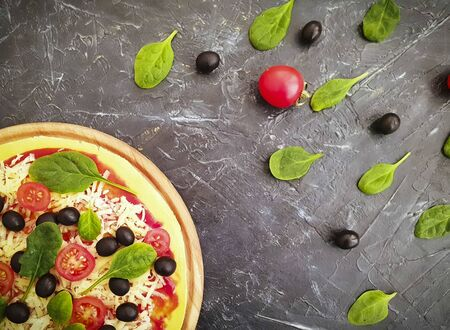pizza with tomatoes, cheese, olives on a concrete background 写真素材