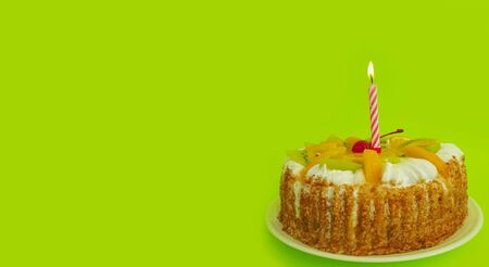 cake candle on a colored background celebrate