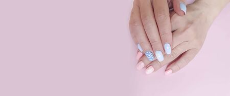 female hand beautiful manicure on a colored 写真素材 - 135309975
