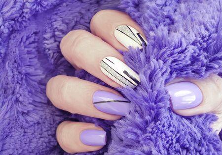 female hand nails beautiful manicure sweater