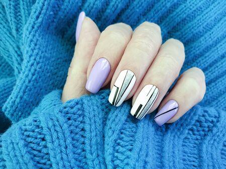 female hand nails beautiful manicure sweater 写真素材