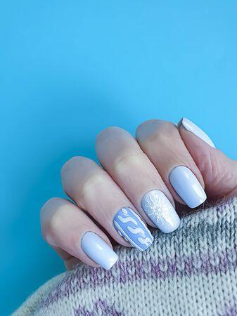 female hand beautiful manicure sweater stylish, fashion