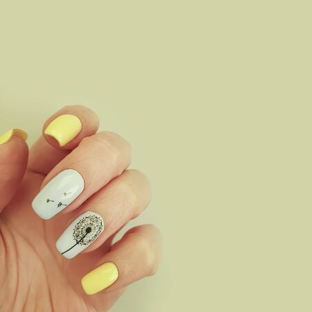 female hand beautiful manicure on a colored paper background 写真素材