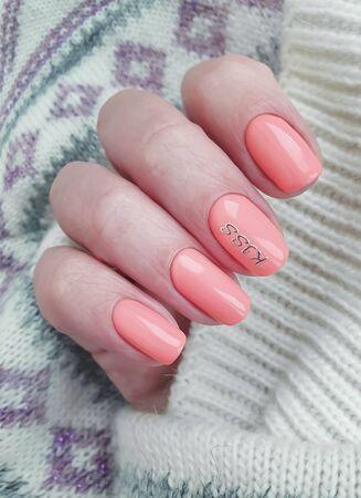 female hand nail beautiful manicure sweater