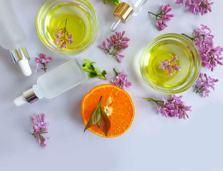 cosmetic cream, flower, orange on a colored background