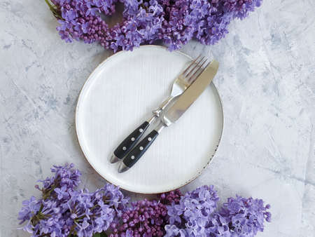 plate flower lilac on concrete background