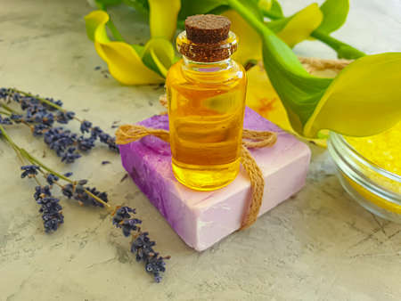 cosmetic oil, soap flower on concrete background