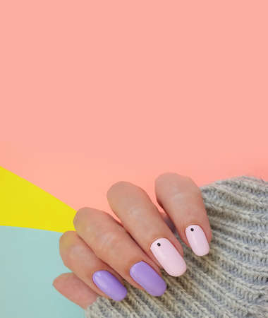 female hand beautiful manicure stylish sweater