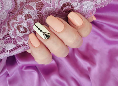 female hand beautiful stylish manicure silk 스톡 콘텐츠